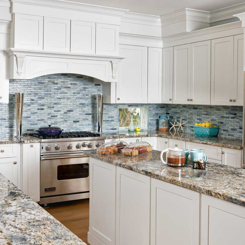 kitchen featuring white fabuwood cabinets